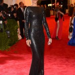 Rihanna walked the MET Gala Red carpet in slick black by Tom Ford!